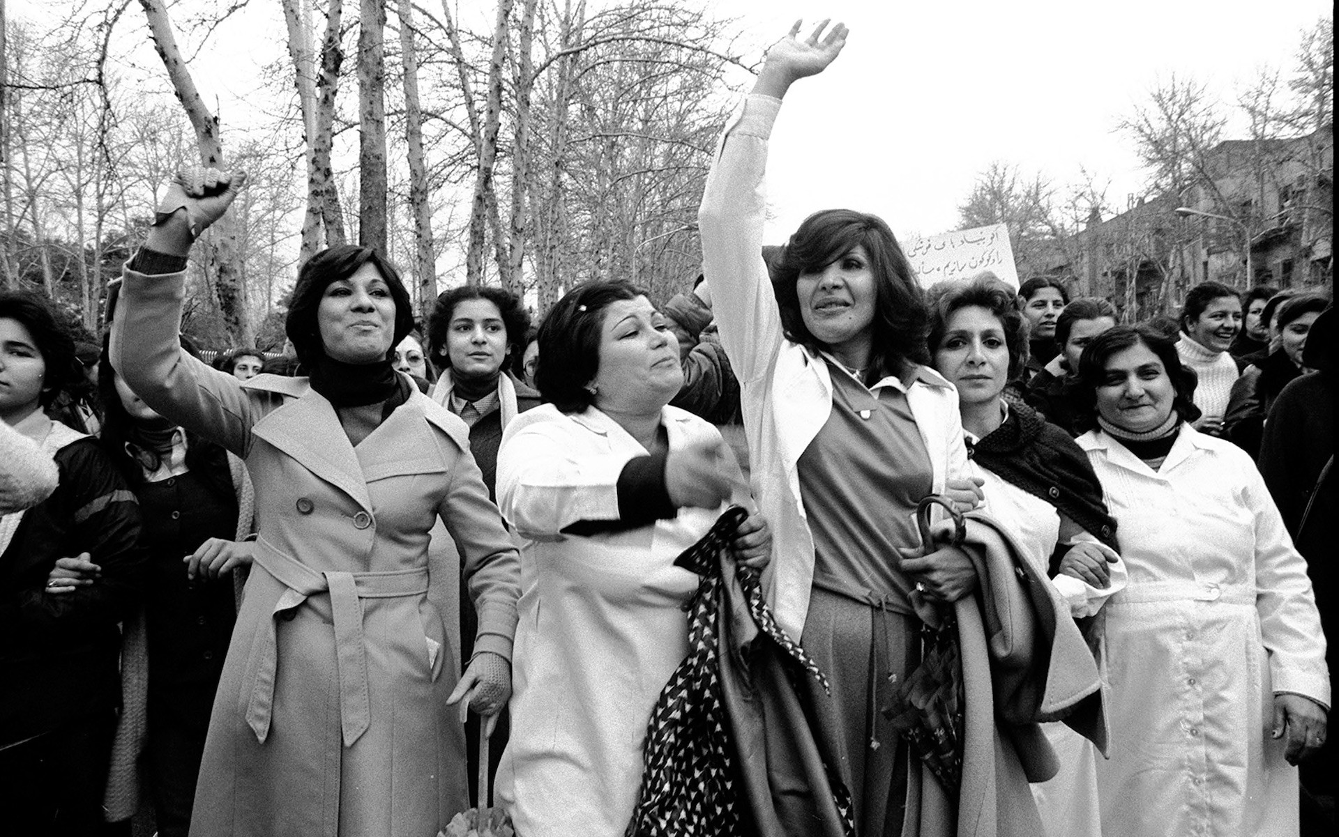 Women join forces to protest against the hijab ruling in Tehran, Iran, 1979 CREDIT: HENGAMEH GOLESTAN
