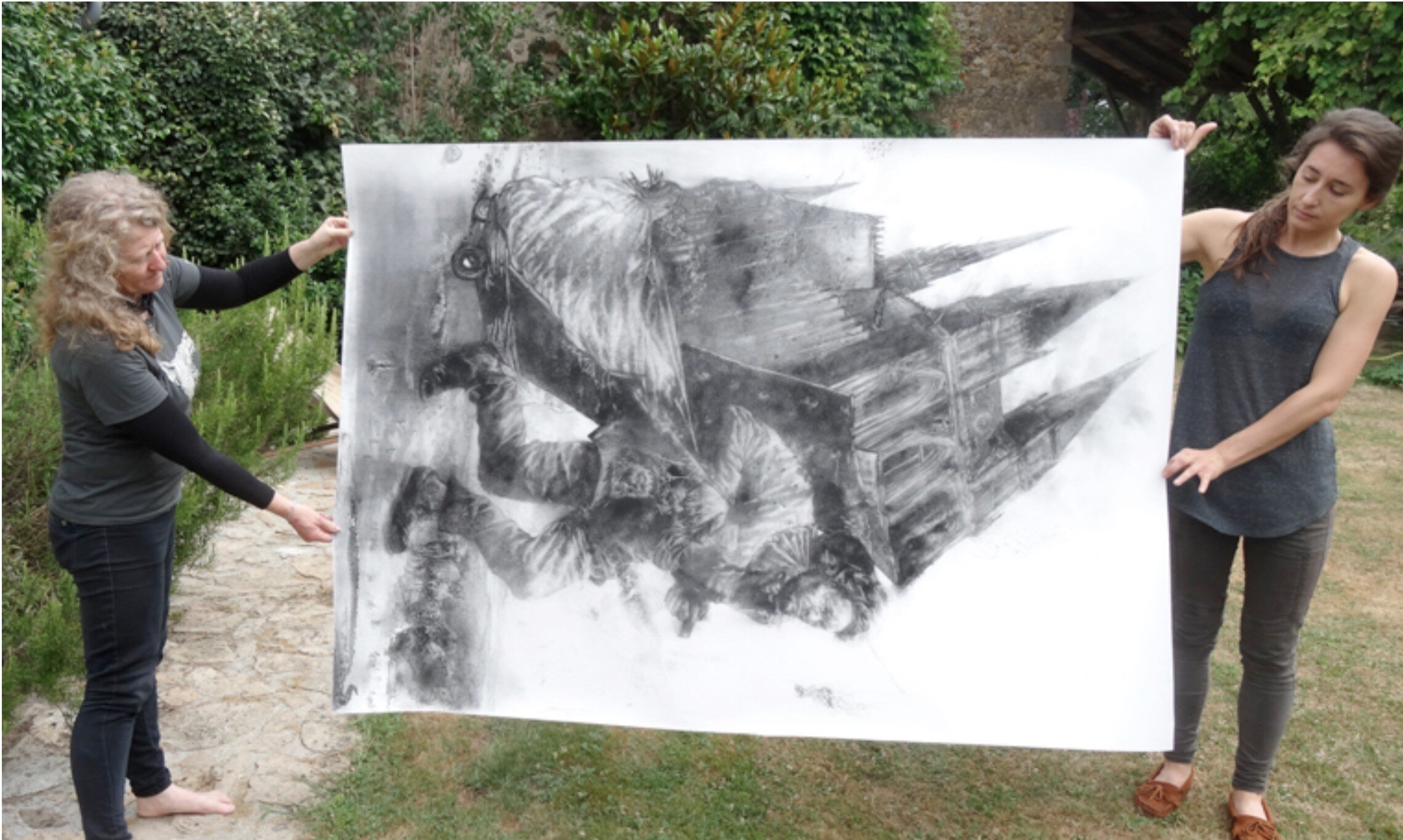 Diane Victor and one of her ash drawings in the garden at Atelier le Grand Village © Atelier Le Grand Village