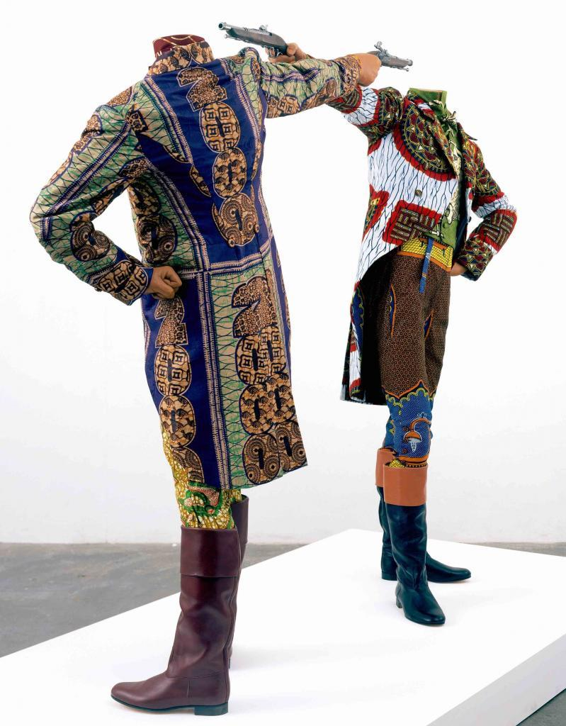Yinka Shonibare CBE, How to blow up two heads at once, Installation, 2 mannequins, dutch wax printed cotton textile, leather riding boots, plinth, 2006, 175 x 245 x 122 cm © Yinka Shonibare, courtesy of Stephen Friedman Fine Art