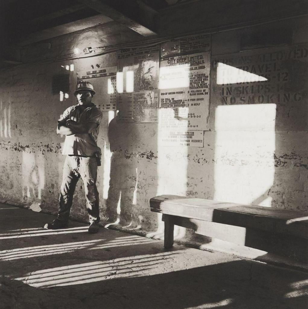 A miner waits on the bank to go underground, City Deep Gold Mine, 1966 Platinum print on Arches Platine 310gm paper 32 3/10 × 27 1/5 in 82 × 69 cm Edition of 10  SOLD FOR: €32,500  Piasa Auction