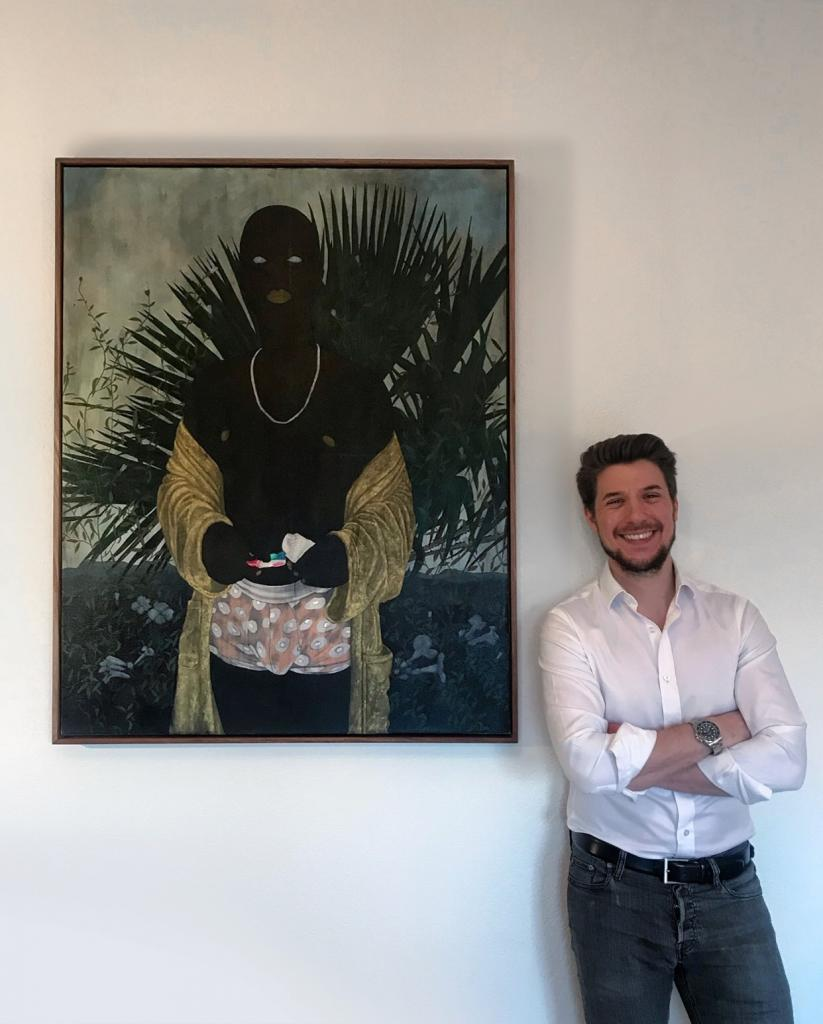 Collector Oliver Elst founder of Cuperior Collection standing beside a painting by Cinga Samson. © Oliver Elst