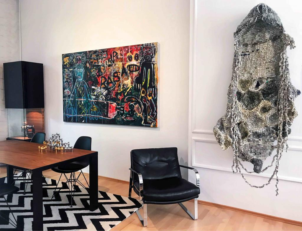 installation view in Oliver Elst home with works by Aboudia and Moffat Takadiwa. © Cuperior Collection