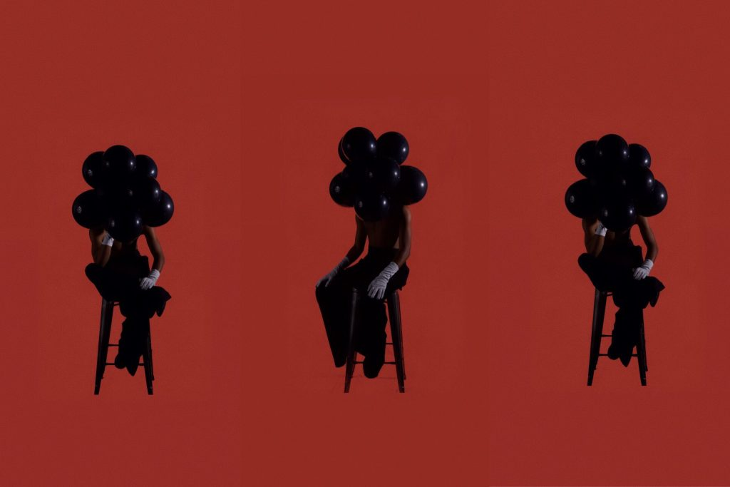 With balloons on his head, K.Skit explores how black bodies often find healing and joy in spite of the generational and ongoing trauma inherited from historical oppression.